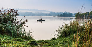 Fisherman on lake Royalty Free Stock Photography