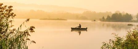 Fisherman on lake Royalty Free Stock Photo