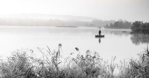 Fisherman on lake Stock Photo
