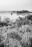 Fisherman on lake Royalty Free Stock Image
