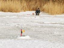 Fisherman on the lake ice fishing rod Royalty Free Stock Photos