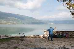 Fisherman by lake Royalty Free Stock Photography