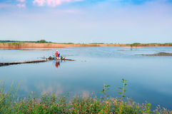 Fisherman on a lake Royalty Free Stock Images