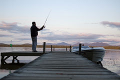 Fisherman on a lake shore Stock Photo