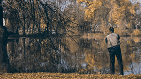 Fisherman on the lake shore stock photos