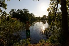 Fisherman. In the lake during sunny day Royalty Free Stock Photography