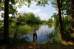 Fisherman. In the lake during sunny day Royalty Free Stock Images