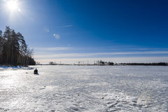Fisherman on lake in Sunny day Stock Photos