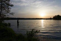 Fisherman. At the lake during sunrise Stock Photos