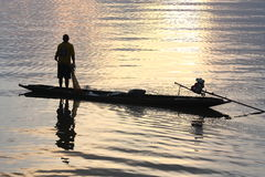 Fisherman in the lake of Thailand.  Royalty Free Stock Photos