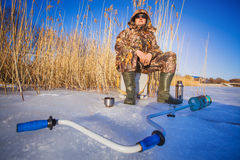 Fisherman on a lake at winter Royalty Free Stock Photo