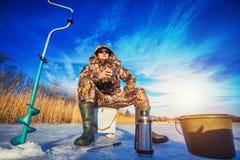 Fisherman on a lake at winter Stock Photos