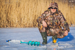 Fisherman on a lake at winter Stock Image