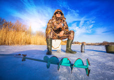 Fisherman on a lake at winter Stock Images