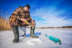 Fisherman on a lake at winter Royalty Free Stock Photos