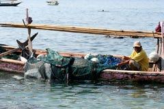 Fisherman.(Lamalera,Indonesia). Fishermen from the fishing village Lamalera unload the fish caught.The village of Lamalera on the Indonesian island of Lembata is royalty free stock images