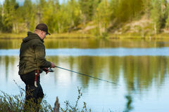 Fisherman and landscape Stock Photography