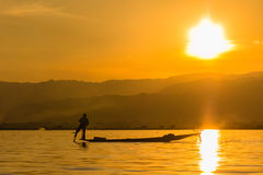 Fisherman with Leg rowing during Sunset,  inle lake in Myanmar ( Royalty Free Stock Photography