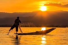 Fisherman with Leg rowing during Sunset,  inle lake in Myanmar ( Royalty Free Stock Images