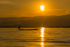 Fisherman with Leg rowing during Sunset,  inle lake in Myanmar ( Stock Images
