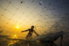 Fisherman. Life sunrise in thailand Royalty Free Stock Image