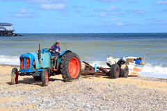 Fisherman loading his boat. Royalty Free Stock Photos