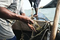 A fisherman with a lobster in Cabo de la vela royalty free stock photography
