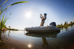Fisherman. Man fishing on a lake Stock Photo