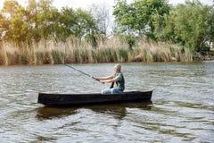 Fisherman-man fishing on river Stock Photos
