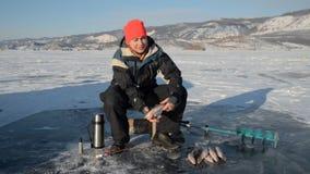 Fisherman is a man in winter fishing. stock footage