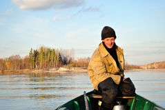 Fisherman for the management of a boat. Conning skipper squinted from the cold autumn wind Stock Image