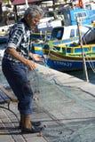Fisherman at Marsaxlokk harbour Stock Images