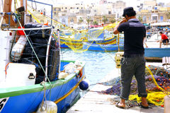 Fisherman, Marsaxlokk, Malta. Royalty Free Stock Photo