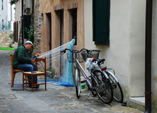 Fisherman Mending Net in Grado Royalty Free Stock Photography