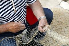 Fisherman Mending Nets Royalty Free Stock Photo