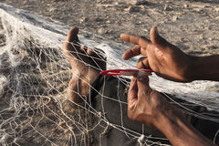 Fisherman. Mending nets in Atlantic coast of Morocco Royalty Free Stock Photography