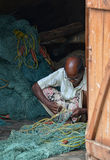 Fisherman Mending Nets Royalty Free Stock Photos