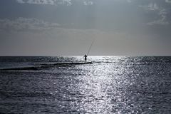 Fisherman in the middle of the sea stock photos
