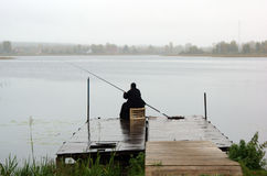 A fisherman monk with fishing rod Stock Photos