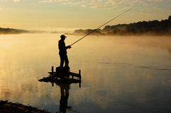 Fisherman. The fisherman in the morning on the river Royalty Free Stock Image
