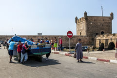 Fisherman move a boat in the port of Essaouira in Morocco. Royalty Free Stock Photos