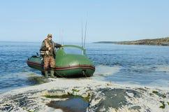 Fisherman near the boat Stock Photos