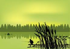 Fisherman near green forest lake Royalty Free Stock Image
