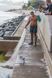 Fisherman with net Barbados Stock Photography