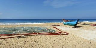Fisherman net on the beach. Fisherman net, drying on the beach near a boat royalty free stock photos