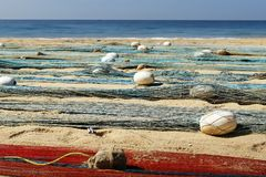 Fisherman net on the beach. Fisherman net, drying on the beach near a boat royalty free stock photography