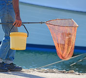 Fisherman with net Stock Photography