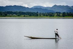 Fisherman in Ngwe Taung Dam, Kayah State, Myanmar Royalty Free Stock Photography