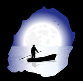 Fisherman in the night Royalty Free Stock Photo