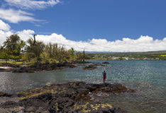 FIsherman at oceanfront park in Hilo Stock Photography